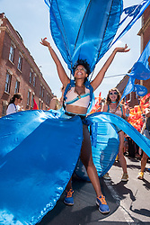 © Licensed to London News Pictures.  07/07/2018; Bristol, UK. Bristol's St Pauls Carnival 50th anniversary, with Miss Windrush. Carnival procession through the streets of St Pauls with many Bristol schools taking part, which has long been a multi-cultural inner city area of Bristol with a a strong Afro-Caribbean community since the Windrush generation. The carnival has not been held for several years due to funding issues but has now secured funding for this year's carnival and beyond. Photo credit: Simon Chapman/LNP