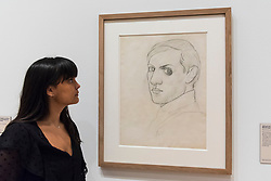 "© Licensed to London News Pictures. 21/01/2020. LONDON, UK. A staff member views ""Self-portrait (Montrouge)"", 1918, by Pablo Picasso at the preview of ""Picasso and Paper"", an exhibition at the Royal Academy of Arts, which is the most comprehensive exhibition ever devoted to Pablo Picasso's imaginative and original uses of paper .  Over 300 works both on and with paper, are on display 25 January to 13 April 2020.  Photo credit: Stephen Chung/LNP"