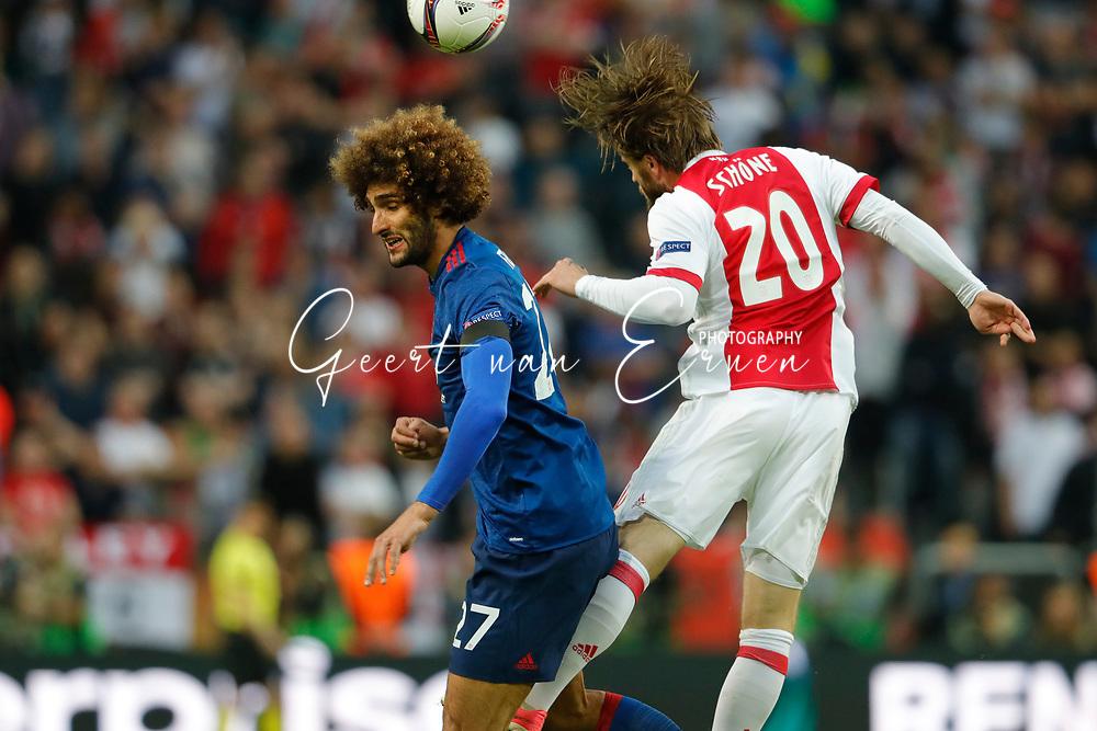 24-05-2017 VOETBAL:AJAX - MANCHESTER UNITED:FINALE:STOCKHOLM<br /> <br /> Marouane Fellaini van Manchester United in duel met Lasse Schone van Ajax <br /> <br /> Foto: Geert van Erven
