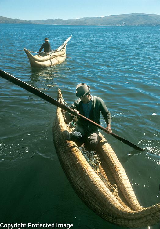 Aymara Indian fishermen in reed rafts called  balsa de totora, on Lake Titicaca, Bolivia