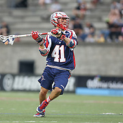 Mike Stone #41 of the Boston Cannons looks to pass the ball during the game at Harvard Stadium on July 19, 2014 in Boston, Massachusetts. (Photo by Elan Kawesch)