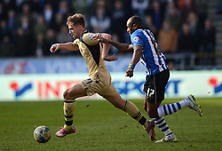 Leeds United's Charlie Taylor competes with Wigan Athletic's Emmerson Boyce - Photo mandatory by-line: Richard Martin-Roberts/JMP - Mobile: 07966 386802 - 07/03/2015 - SPORT - Football - Wigan - DW Stadium - Wigan Athletic v Leeds United - Sky Bet Championship