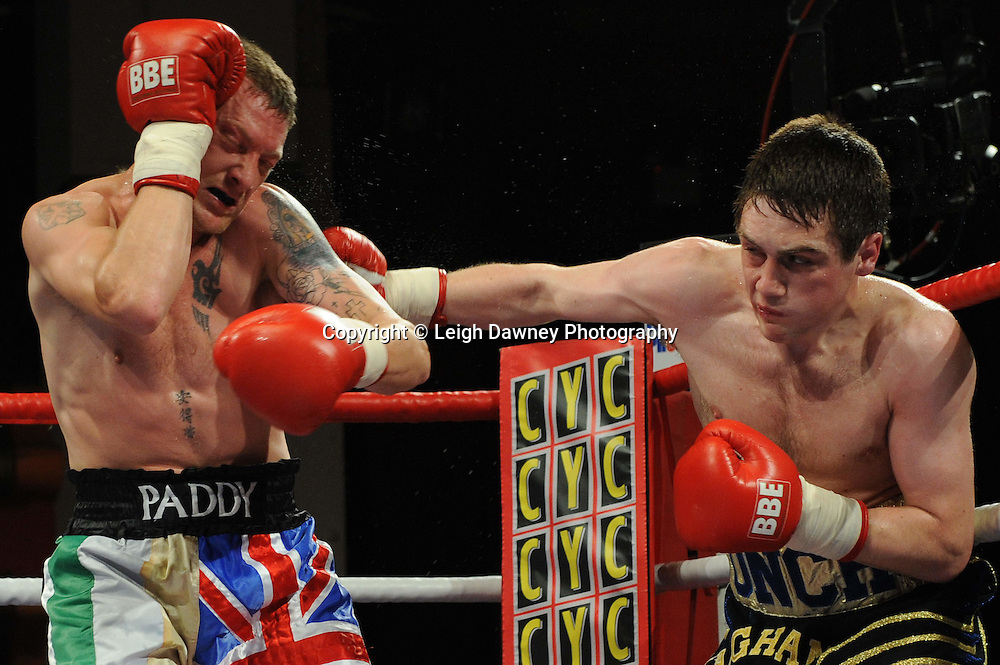 Liam Vaughan (black/gold shorts) defeats Andrew Patterson in a Welterweight contest at Olympia, Liverpool on the 11th June 2011. Frank Maloney Promotions.Photo credit: Leigh Dawney 2011