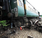 A view of a incident side, where the coaches of Indian Railway were lying on the ground, when anti-talks faction of the National Democratic Front of Bodoland (Ranjan Daimary Group) that is, shortly say - NDFB (R), one of the insurgent group of northeast India, triggered a powerful blast, which flung the locomotive and two numbers of coach of a train (known as - Garib Rath Express) bound for Kolkata (capital of Indian State West Bengal) from Guwahati, the capital of Eastern Indian State, Assam at around 02:28 am, killing a 06-year-old boy (Durlav Sethia) and injuring 23-numbers of  other at Gossaigaon in Kokrajhar district of the Indian State Assam on 08th July, 2010, during Bodo militants, straining at the leash after the arrest of their leader. Pic-Shib Shankar Chatterjee