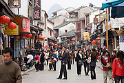 Crowded shopping street in Yangshuo, China
