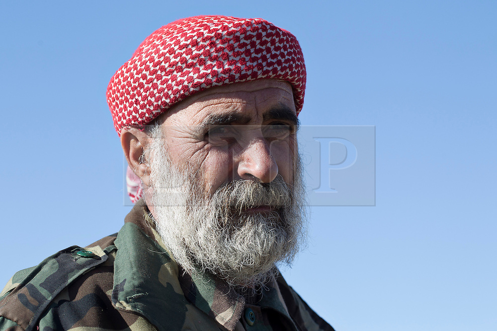 &copy; Licensed to London News Pictures. 11/12/2014. Sinjar Mountains, Iraq. An elderly Yazidi refugee is pictured on the top of Mount Sinjar.<br /> <br /> Although a well publicised exodus of Yazidi refugees took place from Mount Sinjar in August 2014 many still remain on top of the 75 km long ridge-line, with estimates varying from 2000-8000 people, after a corridor kept open by Syrian-Kurdish YPG fighters collapsed during an Islamic State offensive. The mountain is now surrounded on all sides with winter closing in, the only chance of escape or supply being by Iraqi Air Force helicopters. Photo credit: Matt Cetti-Roberts/LNP
