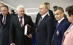 October 11, 2016 - Kovrov, Vladimir Region, Russia - October 11, 2016. - Russia, Vladimir Region, Kovrov. - Russian President Vladimir Putin and Deputy Secretary of the Security Council Rashid Nurgaliev (right) visit the festival 'Sambo Days in the Vladimir Region'. From left to right: Russian Sports Minister Vitaly Mutko and President of the Russian Sambo Federation Sergey Eliseev. (Credit Image: © Russian Look via ZUMA Wire)