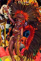 Samba dancer on a float  of the GRES Academicos da Rocinha samba school, Carnaval parade in the Sambadrome, Rio de Janeiro, Brazil.