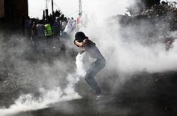 NABLUS, Nov. 11, 2016 (Xinhua) -- A Palestinian protester throws tear gas back at Israeli soldiers during clashes near the West Bank town of Nablus on Nov. 11, 2016. (Xinhua/Nidal Eshtayeh) (gl) (Credit Image: © Nidal Eshtayeh/Xinhua via ZUMA Wire)
