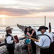 Playas de Tijuana. Life and everyday scenes at the beach of Tijuana. The beginning of the infamous wall between Mexico and United States of America, that starts in the Pacific Ocean and goes all the way for more than 1,000 km until Ciudad Juarrez / El Paso border, in Texas