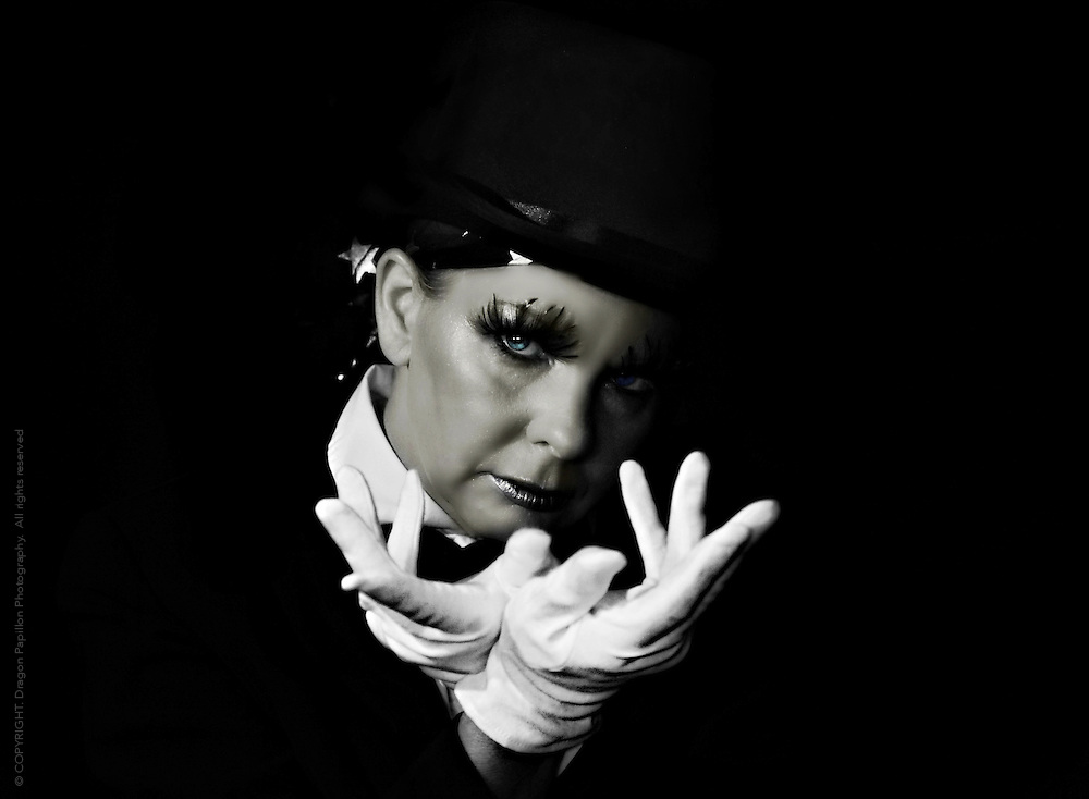 black & white studio portrait with selective colour: female magician