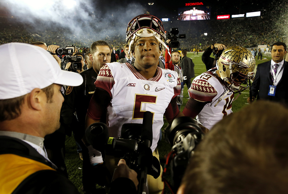 Florida State quarterback Jameis Winston walks off the field after losing to Oregon 59-20 on Thursday January 1, 2015 at the College Football Playoff Semifinal at 101st Rose Bowl in Pasadena, Calif.