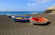 Colourful boats on black sand beach at Ajuy, Fuerteventura, Canary Islands, Spain