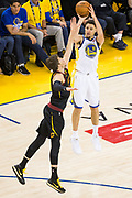 Golden State Warriors guard Klay Thompson (11) shoots a three pointer against the Cleveland Cavaliers during Game 1 of the NBA Finals at Oracle Arena in Oakland, Calif., on May 31, 2018. (Stan Olszewski/Special to S.F. Examiner)