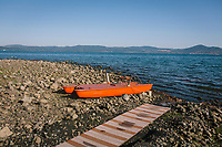 ANGUILLARA SABAZIA (LAKE BRACCIANO), ITALY - 26 JULY 2017: A paddle boat is seen here by Lake Bracciano whose level has dropped more than 1,50 meters recently, in Anguillara Sabazia (Lake Bracciano), Italy, on July 26th 2017.<br /> <br /> Lake Bracciano provides eight percent of Rome's water and has sunk about 1.5 meters<br /> <br /> A severe drought and sweltering temperatures have led Rome city officials to consider a potential rationing of drinking water for eight hours a day for a million and a half Rome residents. The water crisis has become yet another sign of man being at the mercy of an increasingly extreme climate, but also of once mighty Rome's political impotence, managerial ineptitude and overall decline.