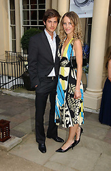 KATE MELHUISH and JACK FREUD at the annual Michele Watches Summer Party held in the gardens of Home House, 20 Portman Square, London W1 on 15th June 2006.<br />