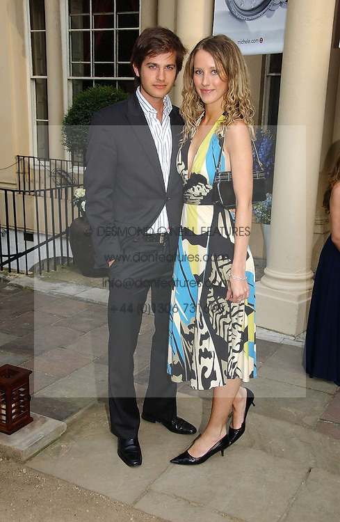 KATE MELHUISH and JACK FREUD at the annual Michele Watches Summer Party held in the gardens of Home House, 20 Portman Square, London W1 on 15th June 2006.<br /><br />NON EXCLUSIVE - WORLD RIGHTS