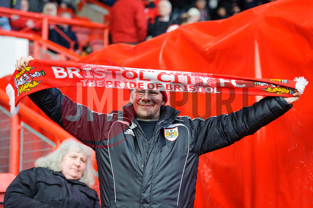A Bristol City holds a flag before the match  - Photo mandatory by-line: Rogan Thomson/JMP - 07966 386802 - 01/03/2014 - SPORT - FOOTBALL - Ashton Gate, Bristol - Bristol City v Gillingham - Sky Bet League One.
