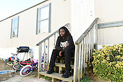 FAYETTEVILLE, NC - DECEMBER 17:  Rakeem Jones sits outside of his home in Fayetteville, NC on December 17, 2016. He's been surprised at the amount of attention his assault at a Trump rally has received, saying he thought it would be over in a few days. (Photo by Liz Condo for The Washington Post)