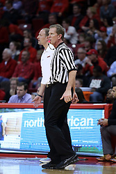 20 January 2017:  Rick Crawford walks the sidelines near Dan Muller, Head Coach during an NCAA Missouri Valley Conference mens basketball game Where the Purple Aces of Evansville lost to the Illinois State Redbirds 75-73 in Redbird Arena, Normal IL
