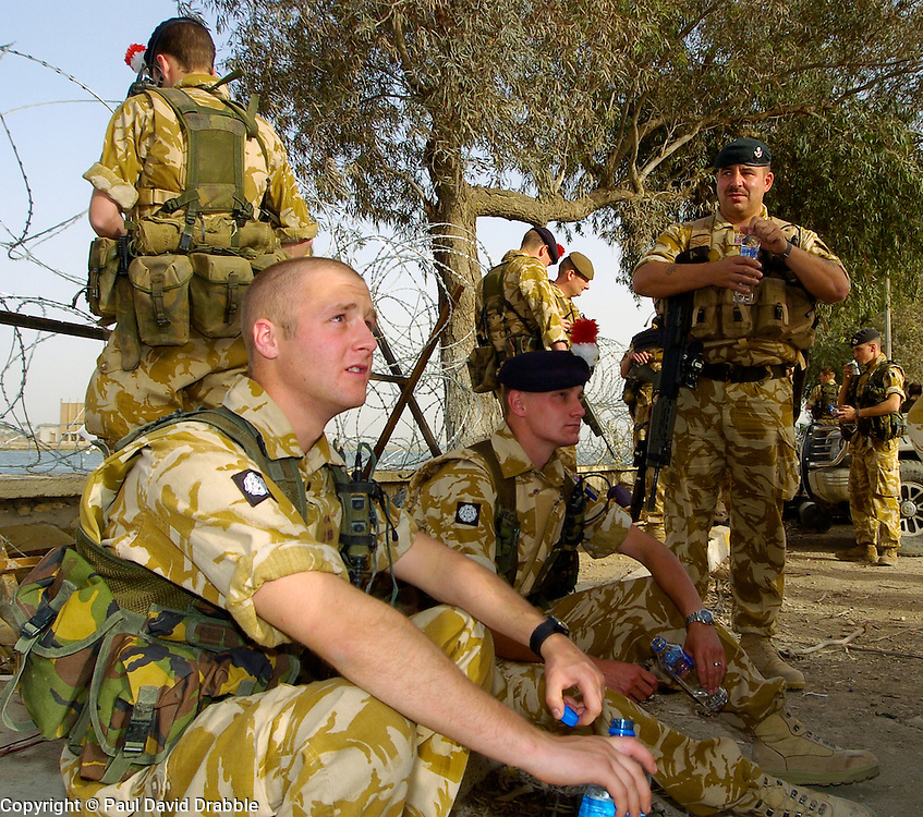 Soldiers from the East and West Riding Regiment, Territorial take a break  in the grounds of the Shat Al Arab Hotel during a break in an mounted patrol through the streets of Basra during Op Telic in March 2005