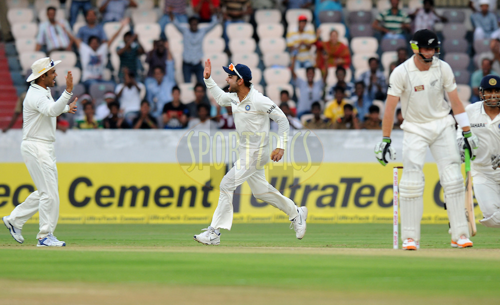 Virat Kohli of India celebrates after completing the catch to get Martin Guptill of New Zealand out during day two of the first test match between India and New Zealand held at The Rajiv Gandhi International Stadium in Hyderabad, India on the 24th August 2012..Photo by: Pal Pillai/BCCI/SPORTZPICS