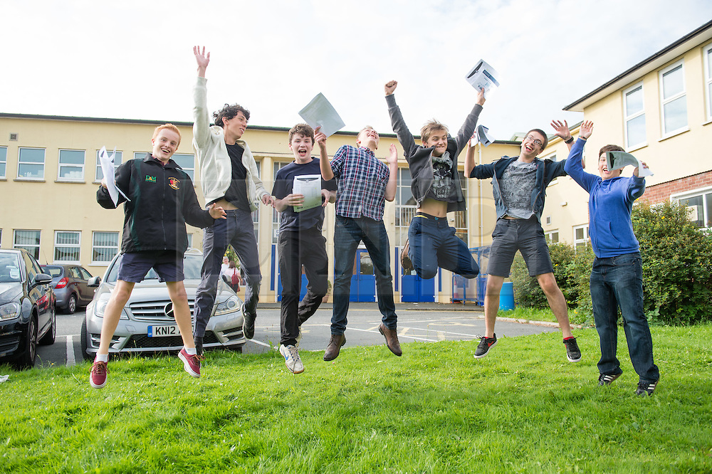 © Licensed to London News Pictures. 25/08/2016. Aberystwyth, Wales, UK. Teenage students boys  at Penglais school Aberystwyth Wales UK celebrate after collecting their GCSE results. Overall in Wales the GCSE A* to C pass rate has remained static  at 66.6%  for the third consecutive  year.  Photo credit: Keith Morris/LNP
