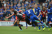 AFC Bournemouth's Captain Tommy Elphick and Leicester City's Wes Morgan during the Barclays Premier League match between Bournemouth and Leicester City at the Goldsands Stadium, Bournemouth, England on 29 August 2015. Photo by Mark Davies.