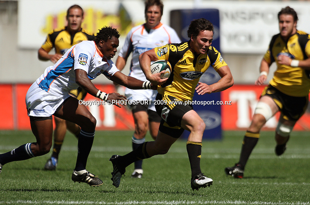 Hurricanes winger Zac Guildford tries to escape his Cheetahs opposite Jongi Nokwe.<br /> Super 14 rugby union match, Hurricanes v Cheetahs at Yarrows Stadium, New Plymouth, New Zealand. Saturday 7 March 2009. Photo: Dave Lintott/PHOTOSPORT
