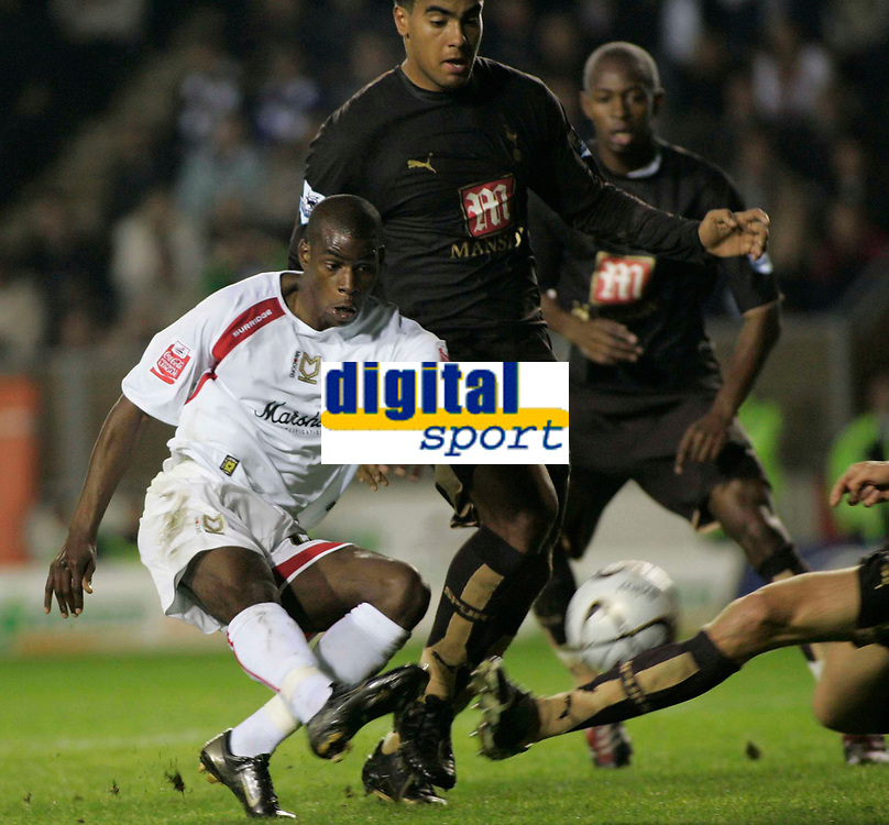 Photo: Marc Atkins.<br /> Milton Keynes Dons v Tottenham Hotspur. Carling Cup. 25/10/2006. Izale Mcleod of Mk Dons tries to slide the ball into the net.