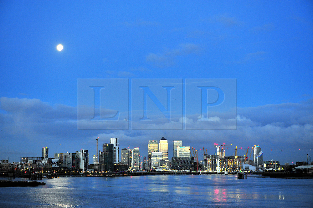 © Licensed to London News Pictures. 14/01/2017<br /> Canary Wharf early this morning.<br /> Cold London weather with Flood warning in place.<br /> The Thames Barrier is open this morning as Thames river levels stay low.<br /> Photo credit :Grant Falvey/LNP