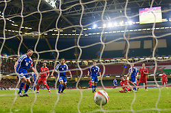 CARDIFF, WALES - Saturday, October 11, 2008: Liechtenstein's Mario Frick deflects Wales' Ched Evans' header past his own goalkeeper for an own goal during the 2010 FIFA World Cup South Africa Qualifying Group 4 match at the Millennium Stadium. (Photo by David Rawcliffe/Propaganda)