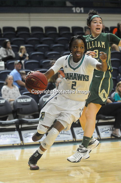UNCW's Brie Mobley drives past William and Mary's Mariena Tremba Sunday January 4, 2015 at Trask Coliseum on the campus of UNCW. (Jason A. Frizzelle)