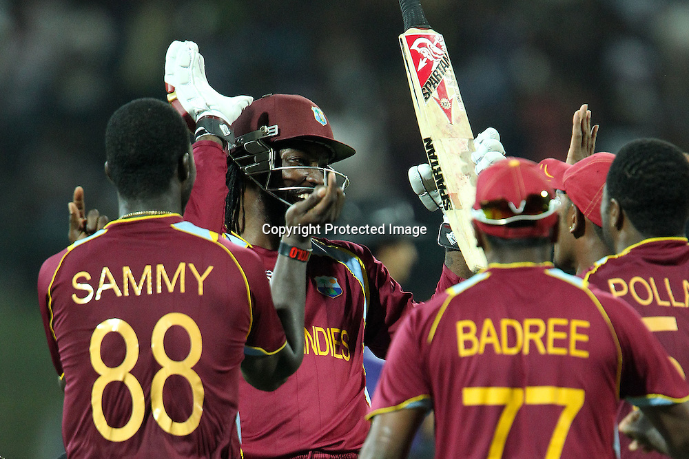 Chris Gayle of The West Indies celebrates the win during the ICC World Twenty20 Super Eights match between The West Indies and New Zealand held at the  Pallekele Stadium in Kandy, Sri Lanka on the 1st October 2012<br /> <br /> Photo by Ron Gaunt/SPORTZPICS/PHOTOSPORT