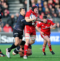 Tommy O'Donnell of Munster takes on the Saracens defence - Photo mandatory by-line: Patrick Khachfe/JMP - Mobile: 07966 386802 17/01/2015 - SPORT - RUGBY UNION - London - Allianz Park - Saracens v Munster - European Rugby Champions Cup