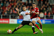 Derby County forward Chris Martin and Bristol City midfielder Joe Bryan during the Sky Bet Championship match between Bristol City and Derby County at Ashton Gate, Bristol, England on 19 April 2016. Photo by Graham Hunt.