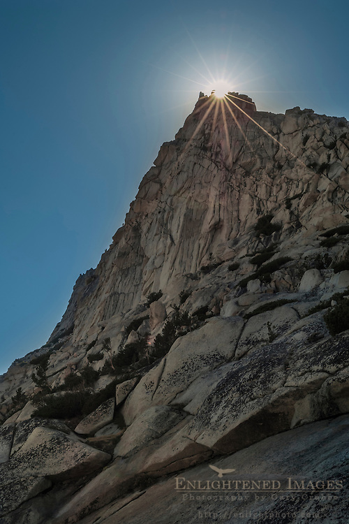 Sunburst behind rocky spire near Vogelsang Pass; Cathedral Range; Yosemite National Park; California