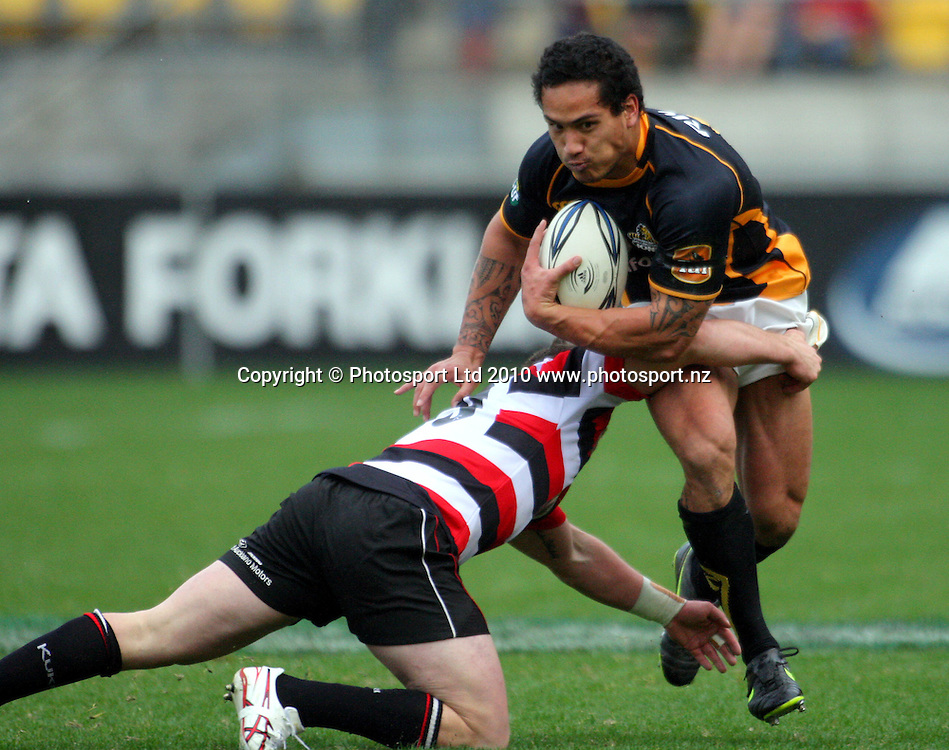 Wellington winger Hosea Gear tries to beat the tackle of Mark Selwyn. ITM Cup - Wellington Lions v Counties-Manukau Steelers at Westpac Stadium, Wellington, New Zealand on Sunday, 8 August 2010. Photo: Dave Lintott/PHOTOSPORT