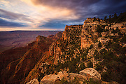 Angels Window and the North Rim of the Grand Canyon at sunrise.