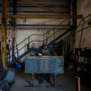 A worker welding machinery at George Fleming farm-equipment company, located two miles from the border between Northern Ireland and Republic of Ireland, in Newbuildings, Derry/Londonderry.