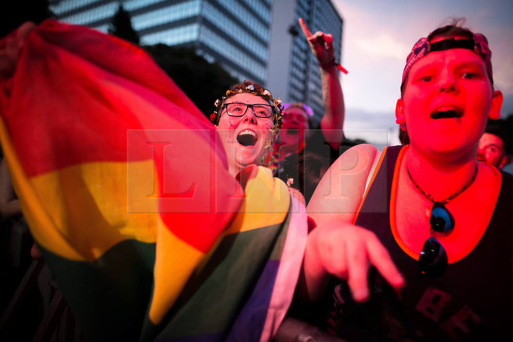 © Licensed to London News Pictures . 26/08/2016 . Manchester , UK . Revellers in front of the Main Stage in Manchester's Gay Village for 2016 Manchester Gay Pride Big Weekend . Photo credit : Joel Goodman/LNP