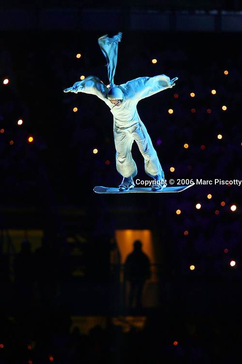A high-flying snowboarder seemingly levitataes in mid-air as he performs over a huge wind machine at the Closing Ceremony for the 2006 Winter Olympics Sunday February 26, 2005 at the Stadio Olimpico in Turin, Italy. The Closing Ceremony featured a dizzying array of circus acts, parades and a general carnival atmosphere. Performers included clowns swivelling in large hoops, ballerinas and tumblers, acrobats dangling high above the stage from ribbons and rings, a stilt walker jumping rope, dancers dressed as Tarot cards and highflying acrobats performing over a tunnel of wind. The Closing Ceremony capped off 16 days of Olympic competition that saw the U.S. win 25 total medals, second to only Germany with 29 total medals..(Photo by Marc Piscotty/ © 2006)