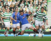 Lee McCulloch tackles Aiden McGeady during the League Cup final between Rangers and Celtic at Hampden Park -<br /> David Young Universal News And Sport