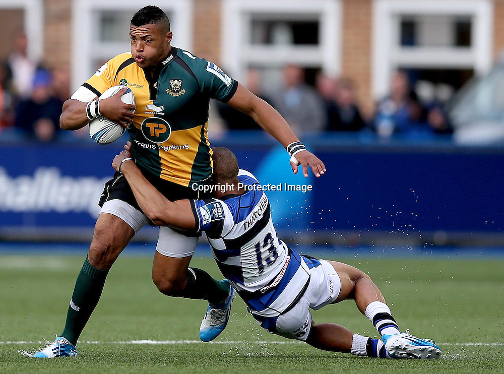 Amlin Challenge Cup Final, Cardiff Arms Park, Cardiff 23/5/2014<br /> Bath vs Northampton Saints<br /> Bath's Jonathan Joseph tackles Luther Burrell of Northampton Saints<br /> Mandatory Credit &copy;INPHO/Dan Sheridan