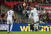England's Ross Barkley heads clear during the UEFA European 2016 Qualifier match between England and Estonia at Wembley Stadium, London, England on 9 October 2015. Photo by Shane Healey.
