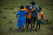 "3 year old Saitoti Dickson, second left, Emily Naikada, first right, Janet Naanyie,  first left and 5 year old Lemayian Sanuni, second right, walk back home in the village of Sitoka, in Kilgoris division, Transmara District, Narok County, Kenya Wednesday, Feb. 5, 2014. <br /> Maasai Anglican Pastor and Parent Moses Ntuskosio, speaks on the Maasai belief that children are not considered part of the tribe until they are three years old, ""The children are not ours, they belong to God. It is God who chooses if they remain. They are not part of the tribe until they are three,"" though the age differs between the clans. One in eleven children die before their fifth birthday. Awareness is being raised through the mother and child outreach programs on sanitation and nutrition in areas where one third of children are stunted and suffer of chronic malnutrition. Hygiene related diseases are the number one cause of mortality between children under age five, this means they could be prevented with knowledge of basic hygiene and sanitation."