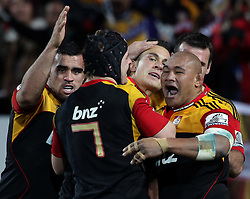 Players congratulate Chiefs' Sonny Bill Williams, centre,  for scoring a try against the Crusaders in a Super Rugby match, Waikato Stadium, Hamilton, New Zealand, Friday, July 06, 2012.  Credit:SNPA / David Rowland