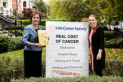 Repro Free: Dublin: 05/10/2105 Kathleen O&rsquo;Meara, Head of Advocacy and Communications at the Irish Cancer Society is pictured with Cancer Survivour Triona Farrell at the launch of the Irish Cancer Society&rsquo;s report of an in-depth survey called &lsquo;The Real Cost of Cancer&rsquo;. The research, which carried out by Millward Brown, shows that many cancer patients and their families face a financial crisis while they are going through their treatment. A large number of patients face a severe drop in income while at the same time running up extra bills on a range of items. <br /> The average extra spend per month for a cancer patient, even those with a medical card or private health insurance, is &euro;862, according to the survey, while those who cannot work, work less or lose income as a result of having cancer face an income drop averaging &euro;1,400 a month, or &euro;16,750 per year. Picture Andres Poveda<br /> Ends<br /> For media information:<br /> &Oacute;rla Sheils<br /> Communications Officer, Irish Cancer Society<br /> T: 01 231 0559 / 087 645 3867