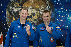 """At the Baikonur Cosmodrome Museum in Kazakhstan, Expedition 57 Nick Hague of NASA (left) and Alexey Ovchinin of Roscosmos (right) display """"launch keys"""" they were presented Oct. 6 during a traditional pre-launch tour of the facility. Hague and Ovchinin will launch Oct. 11 from the Baikonur Cosmodrome on the Soyuz MS-10 spacecraft for a six-month mission on the International Space Station.<br /> <br /> NASA/Victor Zelentsov"""