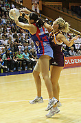 Paula Griffin and Laura Geitz compete for the ball during round 4 of the ANZ Netball Championship - Queensland Firebirds v Northern Mystics. Played at Brisbane Convention Centre. Firebirds (46) defeated the Mystics (40).  Photo: Warren Keir (SMP/Photosport).<br /> <br /> Use information: This image is intended for Editorial use only (e.g. news or commentary, print or electronic). Any commercial or promotional use requires additional clearance.